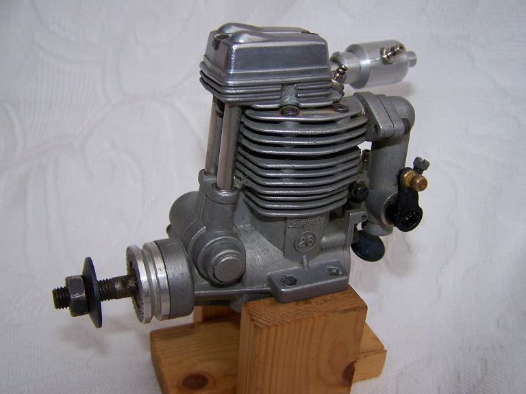 OS FS 26 Surpass 4 stroke model engine.